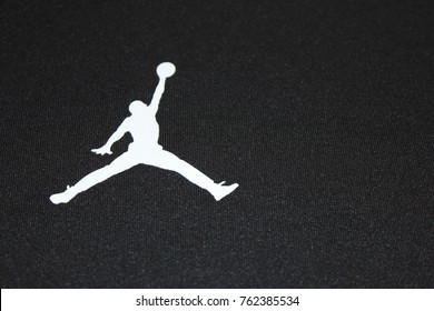 "MOSCOW, RUSSIA - NOVEMBER 2, 2017: Air Jordan Brand ""Jumpman"" Logo on Black Background. Air Jordan is a Nike Company Brand of Basketball Footwear and Sporting Apparel, Designed in United States."