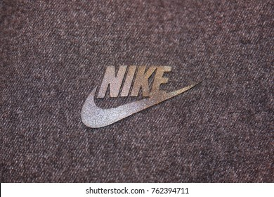 MOSCOW, RUSSIA - NOVEMBER 2, 2017: Nike Sportswear Company Brand Logo on Dark Grey Sweatshirt. Nike is an American Corporation, World's Largest Supplier of Athletic Shoes and Sporting Apparel.