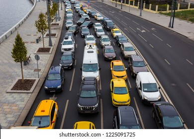 MOSCOW, RUSSIA - NOVEMBER 2, 2018: Cars and taxis are in traffic on the Prechistenskaya embankment due to the overlap of roads in Moscow near the Kremlin