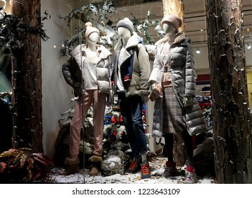MOSCOW, RUSSIA - NOVEMBER, 2012:  Showcases with mannequins in clothing stores. Winter Christmas decoration, night view.