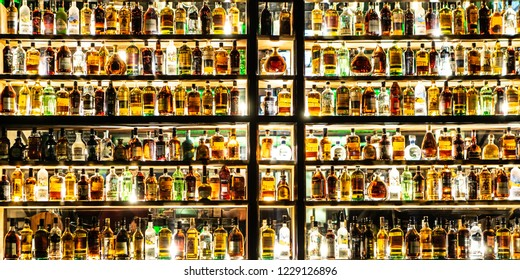 Moscow, Russia - November, 2018: Bottles Of Alcohol And Spirits On Backlight Shelves At A Pub Or Bar. Variety Of French And Imported Famous Labels.
