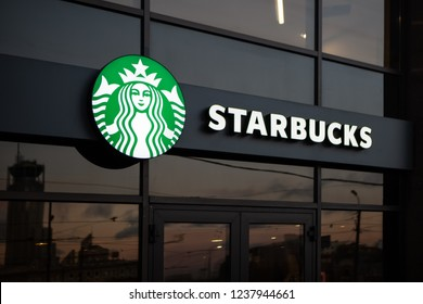 Moscow, Russia - November, 2018: Starbucks Coffee Shop Famous Branches in Moscow. Night Or Evening View. Logo Starbucks Close-Up.