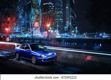 Moscow, Russia - November 21, 2015: Car Subaru Impreza WRX stand in Moscow city near modern buildings at night