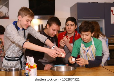Moscow, Russia, November 21, 2017: Unidentified teenager kids cooking pasta on culinary master class - happy event, devoted to the end of school semester in Moscow.
