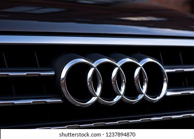Moscow, Russia - November 21, 2018: Audi Logo Close-up On Car Bumper Or Grill. Luxury Automobile Manufacturer.