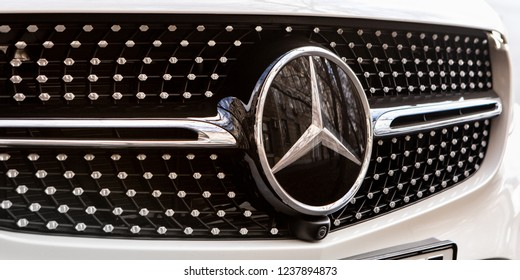 Moscow, Russia - November 21, 2018: Mercedes Benz Logo Close-up On Car Bumper Or Grill. Luxury Automobile Manufacturer, Multinational Division Of German Manufacturer Daimler.