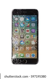 Moscow, Russia - November 22, 2015: Photo of iPhone 6 plus with broken display. Modern smartphone with damaged glass screen isolated on white background. Device needs repair.