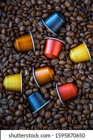 MOSCOW, RUSSIA - NOVEMBER 22, 2019:Nespresso CoffeeCapsules and Coffee BeansBackground Top ViewNatural Light Selective Focus
