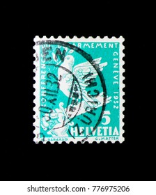 MOSCOW, RUSSIA - NOVEMBER 23, 2017: A stamp printed in Switzerland shows Peace dove on a broken sword, Disarmenent conference serie, circa 1932