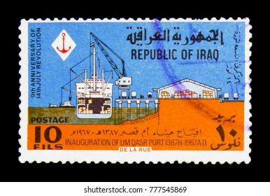 MOSCOW, RUSSIA - NOVEMBER 23, 2017: A stamp printed in Iraq shows Ship to the quay, crane, warehouse, 9th anniversary of the revolution serie, circa 1967