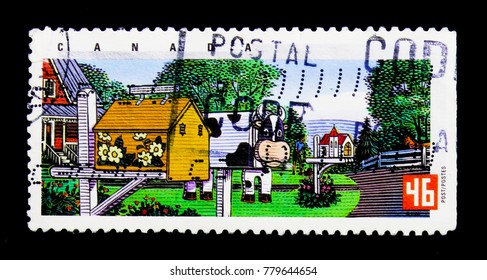 MOSCOW, RUSSIA - NOVEMBER 24, 2017: A stamp printed in Canada shows Flowered house, cow and church, Traditional Rural Mailboxes serie, circa 2000