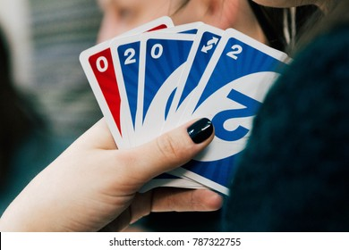 Moscow, Russia November 24th 2017 - Uno cards in female hand; American card game