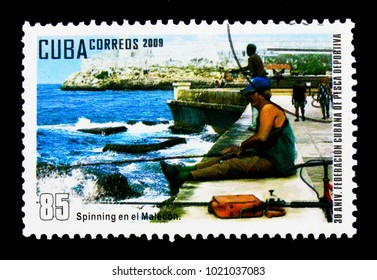 MOSCOW, RUSSIA - NOVEMBER 25, 2017: A stamp printed in Cuba shows Spinning in the Malecon, 30th anniversary of the Fishing Cuban Federation serie, circa 2009