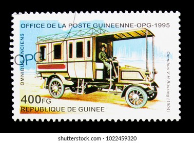 MOSCOW, RUSSIA - NOVEMBER 25, 2017: A stamp printed in Guinea shows Omnibus V.H. Bussing - 1904, Historic Buses serie, circa 1995