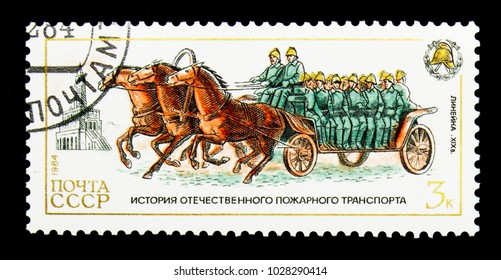 MOSCOW, RUSSIA - NOVEMBER 26, 2017: A stamp printed in USSR (Russia) shows Horse-drawn crew wagon, 19th century, History of Fire Engines serie, circa 1984