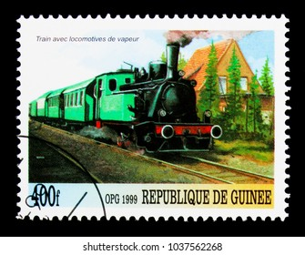 MOSCOW, RUSSIA - NOVEMBER 26, 2017: A stamp printed in Guinea shows Trains and trams, Locomotives of the World serie, circa 1999