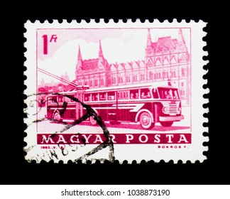 MOSCOW, RUSSIA - NOVEMBER 26, 2017: A stamp printed in Hungary shows Bus and Parliament, Transport and Telecommunication serie, circa 1963