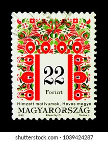 MOSCOW, RUSSIA - NOVEMBER 26, 2017: A stamp printed in Hungary shows Folk motives of Heves County, Hungarian Folk Art serie, circa 1995