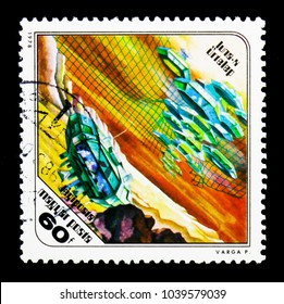 MOSCOW, RUSSIA - NOVEMBER 26, 2017: A stamp printed in Hungary shows Moon settlement, Science Fiction Paintings by Pal Varga serie, circa 1978