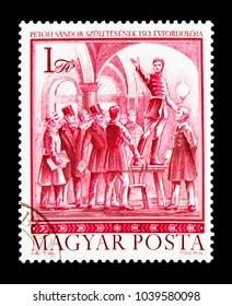 MOSCOW, RUSSIA - NOVEMBER 26, 2017: A stamp printed in Hungary shows Petofi speaking at Pilvax Cafe, Sandor Petofi serie, circa 1972