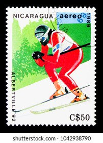 MOSCOW, RUSSIA - NOVEMBER 26, 2017: A stamp printed in Nicaragua shows Downhill skiing, Olympic Games 1992 - Albertville serie, circa 1989
