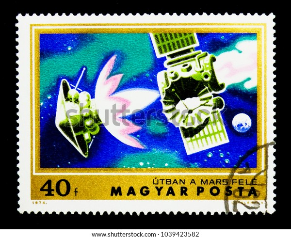 MOSCOW, RUSSIA - NOVEMBER 26, 2017: A stamp printed in Hungary shows Spacecraft enroute to Mars, Exploration of Mars serie, circa 1974