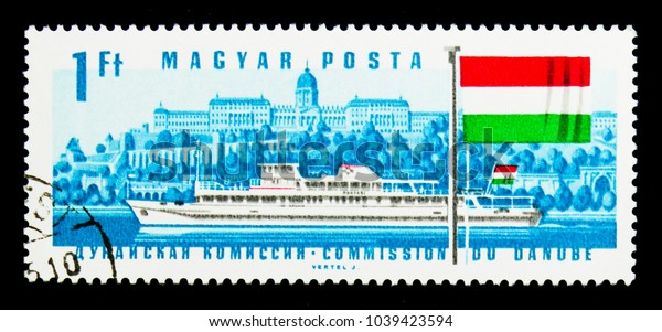 MOSCOW, RUSSIA - NOVEMBER 26, 2017: A stamp printed in Hungary shows Diesel Ship Hunyadi, Buda Castle, Hungarian Flag, Danube Commission serie, circa 1967