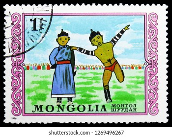 MOSCOW, RUSSIA - NOVEMBER 26, 2018: A stamp printed in Mongolia shows Mongolian wrestling, International Children's Day serie, circa 1976