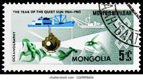MOSCOW, RUSSIA - NOVEMBER 26, 2018: A stamp printed in Mongolia shows Oceanography, International Year of the Sun serie, circa 1965