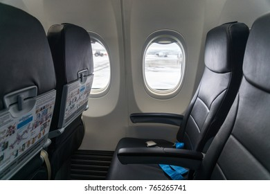 MOSCOW, RUSSIA - November 28 2017: Vnukovo International aipport in Moscow. The seat economy class near the window in the plane of the airline Pobeda aero