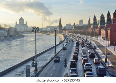 Moscow, Russia, November, 30, 2016. Russian scene: Car traffic on the Kremlin embankment in winter frosty day