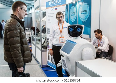 """Moscow, Russia, November 4, 2016: The 4rd International Exhibition of Robotics and advanced technologies """"Robotics Expo"""" in Moscow.Visitors inspect the exposition of robots and new technologies"""