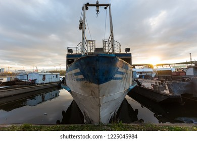 MOSCOW, RUSSIA - NOVEMBER 4, 2018: Cemetery of old ships in the Nagatinskaya floodplain in Moscow in the evening on the river