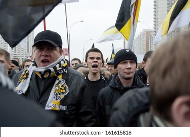 """MOSCOW, RUSSIA - NOVEMBER 4: Unidentified Russian nationalists shout Anti-Islam slogans during annual """"Russian March"""" in Moscow, Russia on November 4, 2013. Nationalism becomes popular among Russians."""