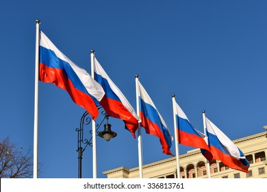 """MOSCOW, RUSSIA - NOVEMBER 6, 2015: Flag of Russian Federation on background of hotel """"Four Seasons"""" in center of Moscow"""