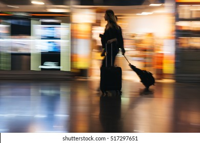 MOSCOW, RUSSIA - Ocober 12, 2016 People run along duty free shops in the Sheremetyevo International Airport - blurred with panning