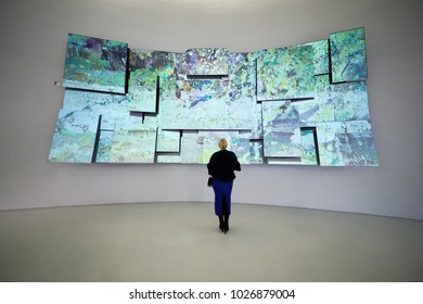 MOSCOW, RUSSIA - OCT 28, 2017: Woman (MR) stands in front of The Breathing Canvas - permanent installation in Museum of Russian Impressionism in Moscow created by american artist Jean Christophe.
