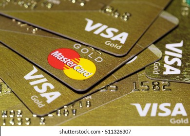 MOSCOW, RUSSIA - OCT 30, 2016: Gold credit cards Visa and MasterCard