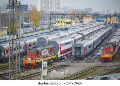 MOSCOW, RUSSIA, OCT,26, 2017: Russian Railways passenger trains in Rizhskaya depot under maintenance. Passenger train depot. RZD passenger coaches cars Train coaches roofs Shunter locomotive depot MOT