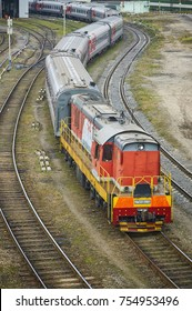 MOSCOW, RUSSIA, OCT,26, 2017: Russian Railways passenger trains in Rizhskaya depot under maintenance. Passenger train lines. RZD passenger coaches cars. Train line curve. Shunter locomotive at depot