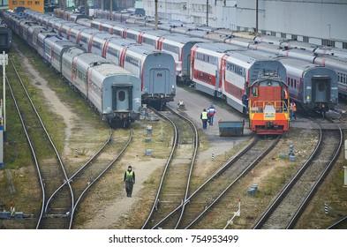 MOSCOW, RUSSIA, OCT,26, 2017: Russian Railways passenger trains in depot under maintenance. Passenger train lines. RZD passenger coaches cars. Double deck passenger coaches Shunter locomotive depot