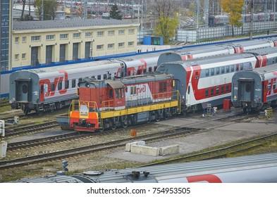MOSCOW, RUSSIA, OCT,26, 2017: Russian Railways passenger trains in Rizhskaya depot under maintenance repair. Passenger train lines. RZD passenger coaches cars. Train coaches. Shunter locomotive depot