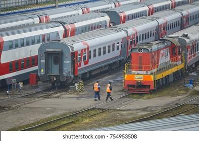 MOSCOW, RUSSIA, OCT,26, 2017: Russian Railways passenger trains in Rizhskaya depot under maintenance. Passenger train lines. RZD passenger coaches cars. Train coaches roofs. Shunter locomotive depot
