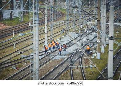 MOSCOW, RUSSIA, OCT,26, 2017: Workers at maintenance of railway tracks and infrastructure. Russian Railways depot repair works. Railroad maintenance workers people staff. Rail road tracks repair