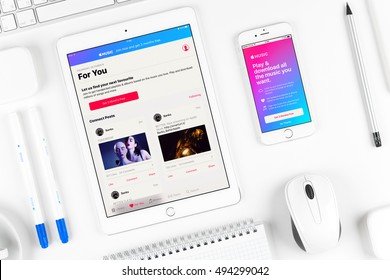 Moscow, Russia - October 04, 2016: Apple music application on the display of iphone and ipad gadgets. Apple Music is a music streaming service developed by Apple Inc.