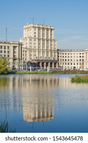 Moscow, Russia - October 05, 2019: Moscow Russia Bauman state technical University main building. Reflection of the building in the pond of Lefortovo Park
