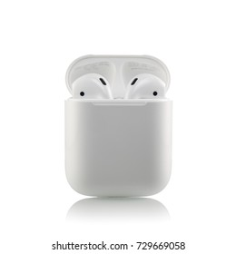 MOSCOW, RUSSIA - OCTOBER 07, 2017: Apple AirPods wireless Bluetooth headphones unboxing with a microphone for  Apple iPhone. New Apple Earpods Airpods in box. Connect to iPhone, Apple Watch, iPad, Mac