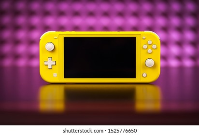 MOSCOW, RUSSIA - October 08, 2019: Nintendo Switch Lite is Nintendo's latest entry into handheld gaming. Priced at $199.99, the Switch Lite is available in yellow color
