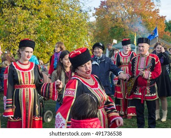 Moscow, Russia, October 1, 2016: Festival Cossack village. Men and women dance traditional Cossack dance
