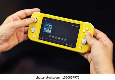 MOSCOW, RUSSIA - October 10, 2019: Nintendo Switch Lite is Nintendo's latest entry into handheld gaming. Priced at $199.99, the Switch Lite is available in yellow color
